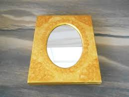 oval mirror in rectangle wooden frame
