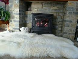 sheepskin rug in front of the fireplace