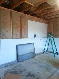insulating and drywalling walls