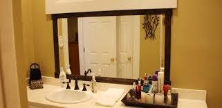 wood frame to a bathroom mirror