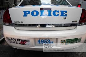 Mediabakery Photo By Age Fotostock Back Of New York Police Department Car With 1 800 Cop Shot Reward Message Usa Cop Shot Fender Sticker On The Rear Of A New York Police Car 10 000