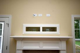 cable box with tv over fireplace