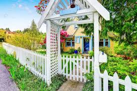 Small Yellow House Exterior With White Picket Fence And Decorative Stock Photo Picture And Royalty Free Image Image 61425705