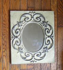 metal shabby frame with oval mirror