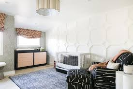 Kids Bedroom Features A Millwork Accent Wall A Black Rocking Chair And A Modern Pink And Black Dresser Hgtv