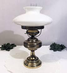 brass hurricane lamp w milk glass globe