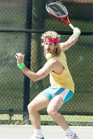Andy Samberg (and his wig) plays Aaron Williams. | It's Samberg vs ...