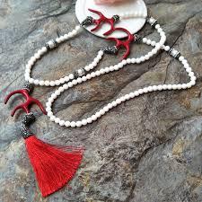 pearl c tassel pendant white