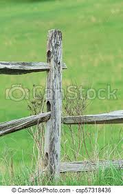 Old Weathered Wooden Fence Post An Old Wooden Weathered Fence Post In Pennsylvanian Countryside