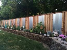 Cinder Block Retaining Wall With Fence On Top Privacy Fence Landscaping Backyard Fences Backyard Privacy