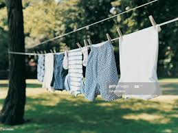 Laundry Drying On A Washing Line In A Garden High Res Stock Photo Getty Images