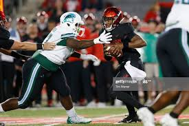 D'Eriq King of the Houston Cougars is pressured by Jeffery Johnson of...  News Photo - Getty Images