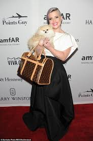 Kelly Osbourne in black and white bringing pooch Polly to the amfAR  Inspiration Gala in NYC   Daily Mail Online