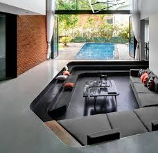 sunken living room sits by the pool