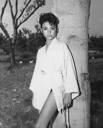 Rita Moreno beautiful young pose in white robe by tree 16x20 Poster at  Amazon's Entertainment Collectibles Store