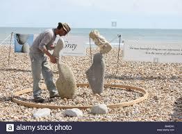Adrian Gray stone balancing on Lyme Regis Stock Photo - Alamy