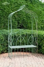 pale green gothic arch seat garden arbour