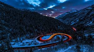long exposure lights road forest snow