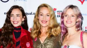Jerry Hall is dazzling in gold on rare outing with lookalike ...