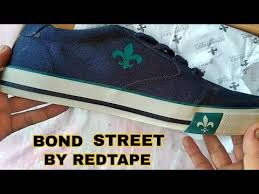 bond street blue sneakers by red tape