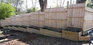 How To Build A Fence On A Slope Today S Homeowner Sloped Garden Sloped Yard Backyard Fences