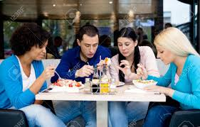 Group Of Teenagers Students On Lunch In Restaurant Stock Photo ...