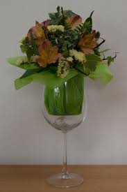 wine glass flower arrangement