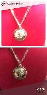 avon paris silver medallion necklace
