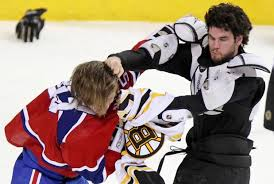 Montreal Canadiens Ryan White (left) fights with Boston Bruins ...