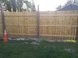 What Would Be The Best Way To Fill The Gap Along The Bottom Of This Fence For A Dog I Was Going To Pick Up Some Free