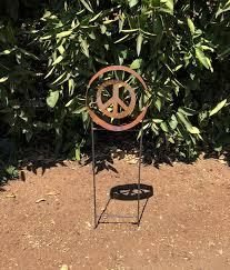 peace symbol sculpture spinner garden