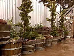 wildly whimsical barrel planter ideas