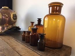 set of 7 old brown laboratory jars