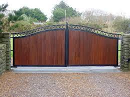 wooden gates with black metal frame