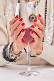 red wine in female hands stock photo