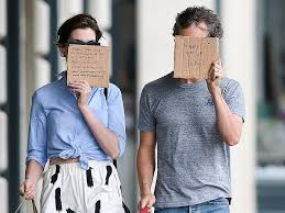 Adam Shulman and Anne Hathaway Support Charity by Hiding Faces | Around the  Globe