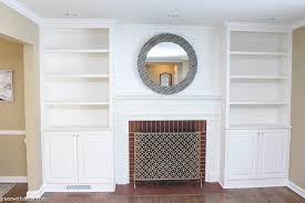 white built in bookshelves around the