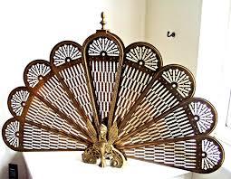brass gargoyle fan fireplace screen