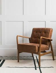 on and stud brown leather armchair