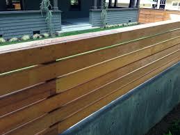 Wood Trellis On Top Of Concrete Retaining Wall Concrete Retaining Walls Retaining Wall Brick Fence