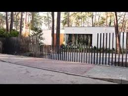 A New Fencing System Uses The Same Tried And Tested Hardware As A Standard Sliding Gate But With A Twist The Verticall Fancy Fence Fence Design Garden Cabins