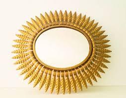 stunning golden sunburst mirror