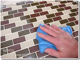 cleaning grout dye haze off of glass