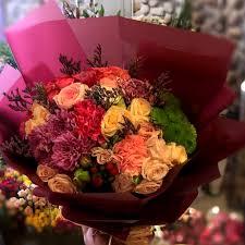 بوكيه ورد ملون الحب والورد فى احلى بوكيه شوق وغزل
