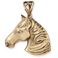 heavy solid 9ct gold horse head pendant