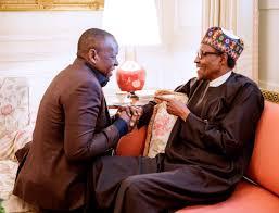 Caption this photo of Sahara Energy co-founder, Tope Shonubi kneeling to  greet President Buhari in Washington