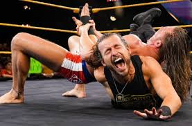 Adam Cole pulled from NXT tour, has cast on right arm