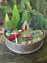 miniature camping scene with canoe tent