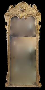 a queen anne giltwood mirror in the