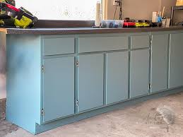 how to paint veneer cabinets for a